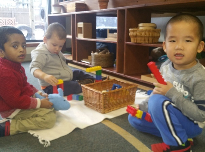 Toddler - boy trio building with legos copy